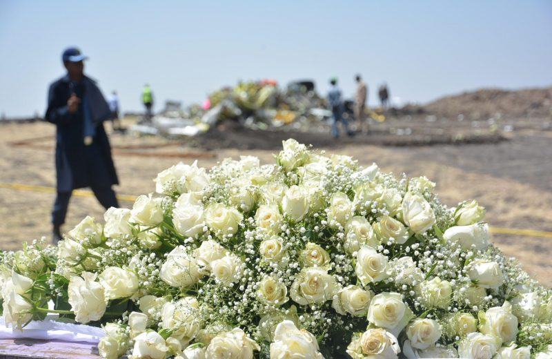 Flowers at the crash site of Ethiopian Airlines plane